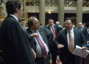 Rep. Jerry Nolte and Rep. Tim Flook consult with Speaker Pro Tem Bryan Pratt