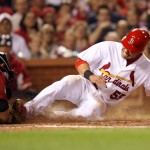 Skip Schumaker nailed at the plate by Michael Bourne. UPI/Bill Greenblatt