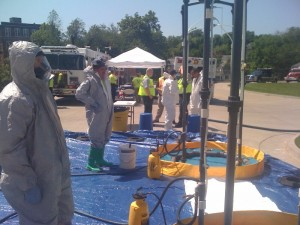 The Hazmat team demonstrates how to use emergency showers