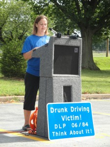 Gail Rehme, David's sister, speaks at the installation ceremony in Florrisant.