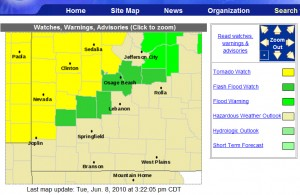 Green areas are flash flood watches and warnings; yellow areas are under a tornado watch. Click the image to go to the National Weather Service Springfield website.