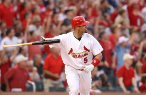 Albert Pujols flips his bat as he watches one of his two homers. UPI/Bill Greenblatt