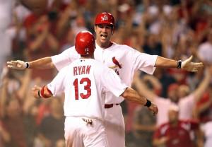 Brendan Ryan and Adam Wainwright celebrate at home plate in the ninth inning.  UPI/Bill Greenblatt