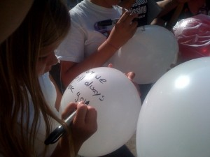 Friends and family signed ballons in front of the Courthouse with messages to Jasmine Haslag