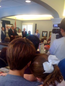 Families watch the ceremony for the signing of H.B. 1311