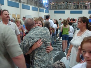 Families share one last hug goodbye before deployment. Fortunately, there have been no deaths among any of the previous ADT's.