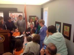 Gov. Nixon signs the bill