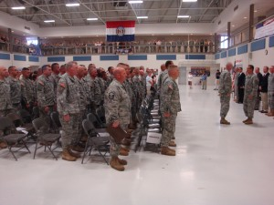 The team gets its final orders before the ceremony ends.