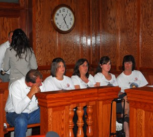 "Elizabeth Olten's mother, far right, waits with other friends and family for the hearing to begin in the Cole County Courthouse. They wore t-shirts the read ""Justice for Elizabeth."""
