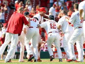 Matt Holliday is mobbed by teammates after his game winning hit.  UPI/Bill Greenblatt