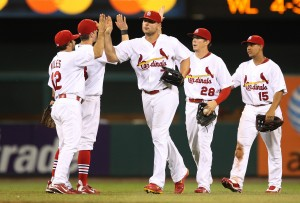 Matt Holliday, Colby Rasmus and Jon Jay celebrate with teammates after their 5-1 win over the Phillies.  UPI/Bill Greenblatt