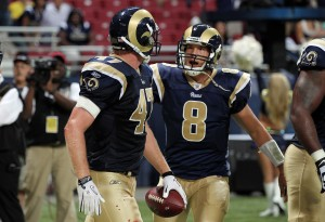 Sam Bradford congratulates Billy Bajema on their two yard touchdown.  UPI/Bill Greenblatt