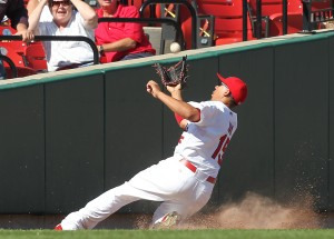 Jon Jay makes a sliding catch along the outfield wall in the ninth inning.  UPI/Bill Greenblatt