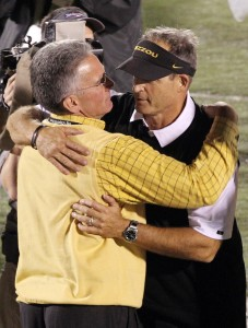 Missouri Tigers head football coach Gary Pinkel (R) is hugged by athletic director Mike Alden after defeating the top ranked Oklahoma Sooners 36-27 at Faurot Field in Columbia, Missouri on October 23, 2010.   UPI/Bill Greenblatt