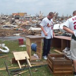 Members of the Springfield Cardinals look over damage from the Joplin tornado. Team phots