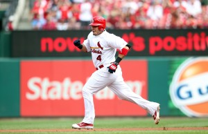 St. Louis Cardinals Yadier Molina scampers towards second base after clearing the bases loaded with a hit in the third inning. UPI/Bill Greenblatt