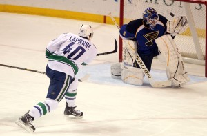 Brian Elliott stops a breakaway.  Elliott lost 3-2 to Vancouver on the day he found out he was named to the NHL All Star roster .  UPI/Bill Greenblatt