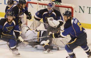 St. Louis Blues goaltender Brian Elliott keeps his eye on the action as Nashville Predators Gabriel Bourque crashes into the net during the third period at the Scottrade Center in St. Louis on March 27, 2012. St. Louis defeated Nashville 3-0. UPI/Bill Greenblatt