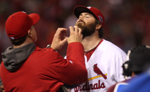 St. Louis Cardinals hitting coach Mark McGwire prepares to run his fingers through the beard of closing pitcher Jason Motte after the third out and a 3-1 victory of the San Francisco Giants in the NLCS.  UPI/Bill Greenblatt