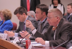 From right, the new House Appropriations Committee on Infrastructure and Job Creation's Chairman Chris Kelly and Vice-Chairman Lincoln Hough listen to the committee's first testimony.  (Photo courtesy; Tim Bommel, Missouri House Communications.)