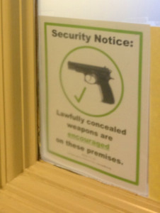 Some legislators have posted signs at their office entrance showing their support for legal firearms possession.