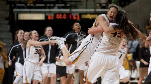 Missouri's Liz Smith, right, is hugged by teammate Liene Priede as the Tigers rush the court after they upset Tennessee (Mizzou Athletics)