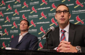 St. Louis Cardinals manager Mike Matheny (L) listens as General Manager John Mozeliak announces that the team's pitching ace Chris Carpenter will unlikely return to the rotation for the 2013 season.   UPI/Bill Greenblatt