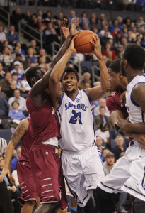 Saint Louis Billikens Dwayne Evans tries to get by Saint Joseph's Hawks Papa Ndao.   UPI/Bill Greenblatt