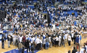 Fans storm the court after SLU upsets #9 Butler. (Saint Louis Athletics)