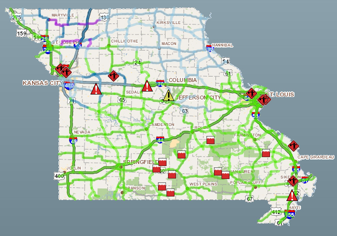 Green means clear, blue means partially covered, and purple means covered. Visit www.modot.org for more.