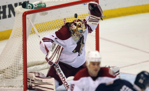Phoenix Coyotes goaltender Mike Smith misses the puck with his glove, over his head for a goal off the stick of St. Louis Blues Chris Stewart.     UPI/Bill Greenblatt