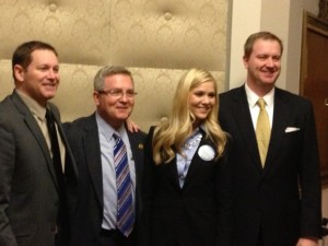 Miss America 2008 Kirsten Haglund stands with State Senators Ryan McKenna (D-Crystal City), David Pearce (R-Warrensburg), and Eric Schmitt (R-Kirkwood) during the 5th Annual Missouri Eating Disorders Advocacy Day.