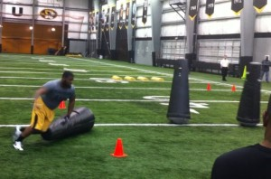 Sheldon Richardson completes a drill in front of St. Louis Rams scouts.
