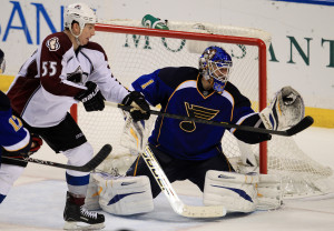 St. Louis Blues goaltender Brian Elliott makes a glove save in front of Colorado Avalanche's Cody McLeod in the third period at the Scottrade Center in St. Louis on April 23, 2013. St. Louis won the game 3-1.    UPI/Bill Greenblatt