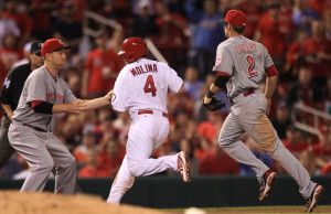 St. Louis Cardinals Yadier Molina is tagged out by Cincinnati Reds third baseman Todd Frazier after being caught in a rundown in the eighth inning at Busch Stadium in St. Louis on April 29, 2013. Cincinnati won the game 2-1. UPI/Bill Greenblatt
