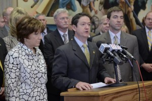 Representatives Sue Allen (left) and Jay Barnes (right) join House Speaker Tim Jones (center) and other House Republicans in announcing changes in a DSS contract the caucus had concerns with.  (Photo courtesy; Tim Bommel, Missouri House Communications)