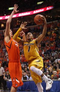 Missouri Tigers Phil Pressey (1) moves past Illinois Illini Tyler Griffey for two of his 12 points in the 82-73 win in the 32nd Annual Braggin' Rights game at the Scottrade Center in St. Louis on December 22, 2012. UPI/Bill Greenblatt