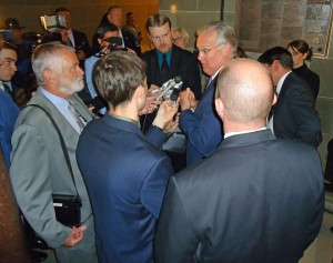 Governor Jay Nixon fields questions from reporters about CCW scans and their handling after speaking at a Medicaid expansion rally in the State Capitol Rotunda.