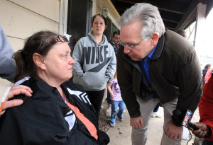 Missouri Governor Jay Nixon consoles a resident who suffered tornado damage to her home in Hazelwood, Missouri on April 11, 2013. An EF-2 tornado bounced a path through the St. Louis area late April 10, 2013. Minor injuries were reported and officials say more than 100 homes have significant damage. At the height of the storm, more than 45,000 people were without electricity.  UPI / Bill Greenblatt
