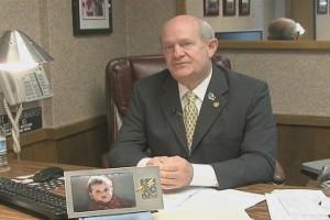 Representative Dwight Scharnhorst with a picture of his late grandson, Bryce.