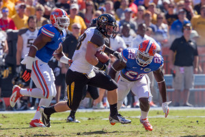T.J. Moe fights for extra yards in a game last season against Florida.