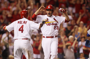 St. Louis Cardinals David Freese and Yadier Molina celebrate at home plate after scoring on a single by Daniel Descalso in the eighth inning against the Kansas City Royals at Busch Stadium in St. Louis on May 29, 2013. St. Louis won the game 5-3.  UPI/Bill Greenblatt