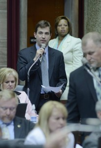 Representative Jay Barnes speaks on the House floor on SB 125 while it's Senate sponsor, Senator Jamilah Nasheed, looks on.  Barnes handled her bill in the House.  (photo courtesy; Tim Bommel, Missouri House Communications)