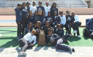 Members of the Lincoln University outdoor track and field team celebrate their conference championship (courtesy TheMIAA.com)