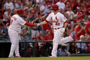 St. Louis Cardinals third base coach Jose Oquendo shakes the hand of starting pitcher Shelby Miller as he touches third base after hitting a solo home run in the fifth inning against the Arizona Diamondbacks at Busch Stadium in St. Louis on June 6, 2013.  UPI/Bill Greenblatt