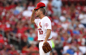 St. Louis Cardinals starting pitcher Adam Wainwright adjusts his cap after giving up a back to back home run to Chicago Cubs Cody Ransom in the first inning at Busch Stadium in St. Louis on June 18, 2013.    UPI/Bill Greenblatt