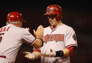 Arizona Diamonbacks Paul Goldschmidt slaps hands with first base coach Steve Sax after delivering a winning RBI single in the 14th inning against the St. Louis Cardinals at Busch Stadium in St. Louis on June 4, 2013.  Arizona won the game 7-6. UPI/Bill Greenblatt