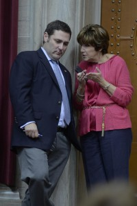 Representative Mike Colona (left) talks to Representative Sue Allen (right), whom he praises for her work on the bullying issue, saying it is a real issue for her and not politics.  (photo courtesy; Tim Bommel, Missouri House Communications)