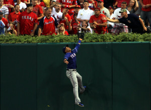 Texas Rangers Leonys Martin tries to a catch on a St.Louis Cardinals David triple in the 2nd inning at Busch Stadium in St. Louis on June 22, 2013. The Rangers defeated the Cardinals 4-2      UPI/Rob Cornforth