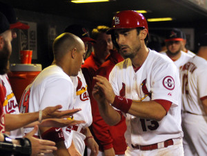 St. Louis Cardinals Matt Carpenter (R) gets hand shakes from the dugout after he hit a home run againist Texas Rangers in the 6th inning at Busch Stadium in St. Louis on June 23, 2013.       UPI/Rob Cornforth